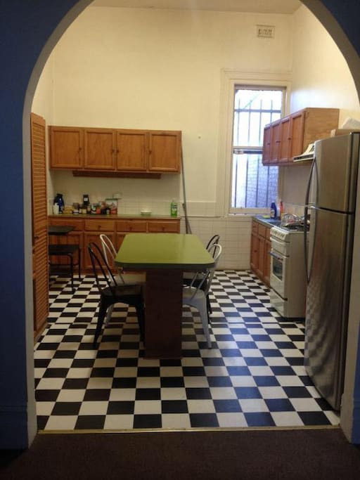 Large spacious kitchen, complete with over, stove, fridge, microwave and dining table