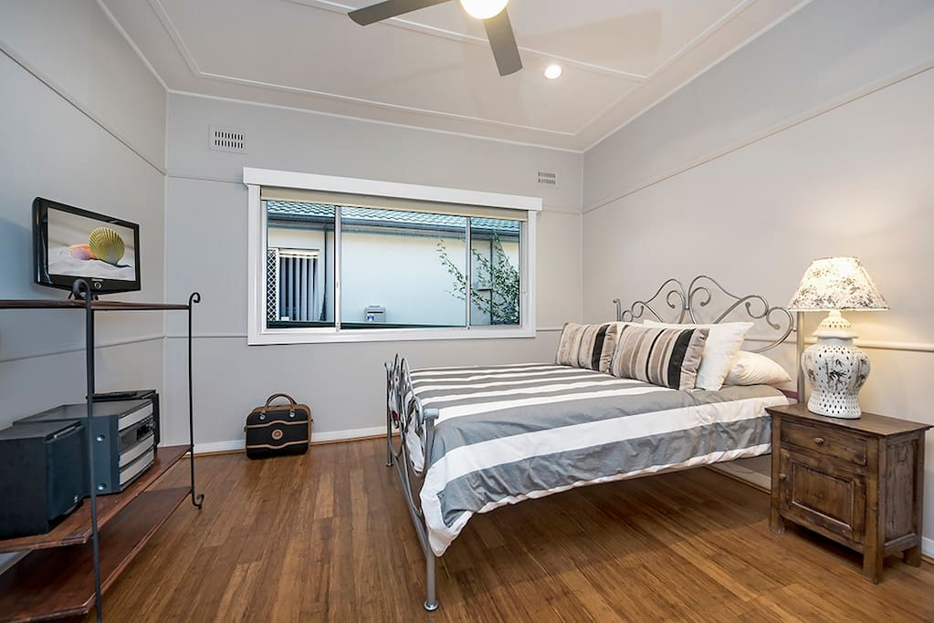 Main bedroom with qn bed and ceiling fan