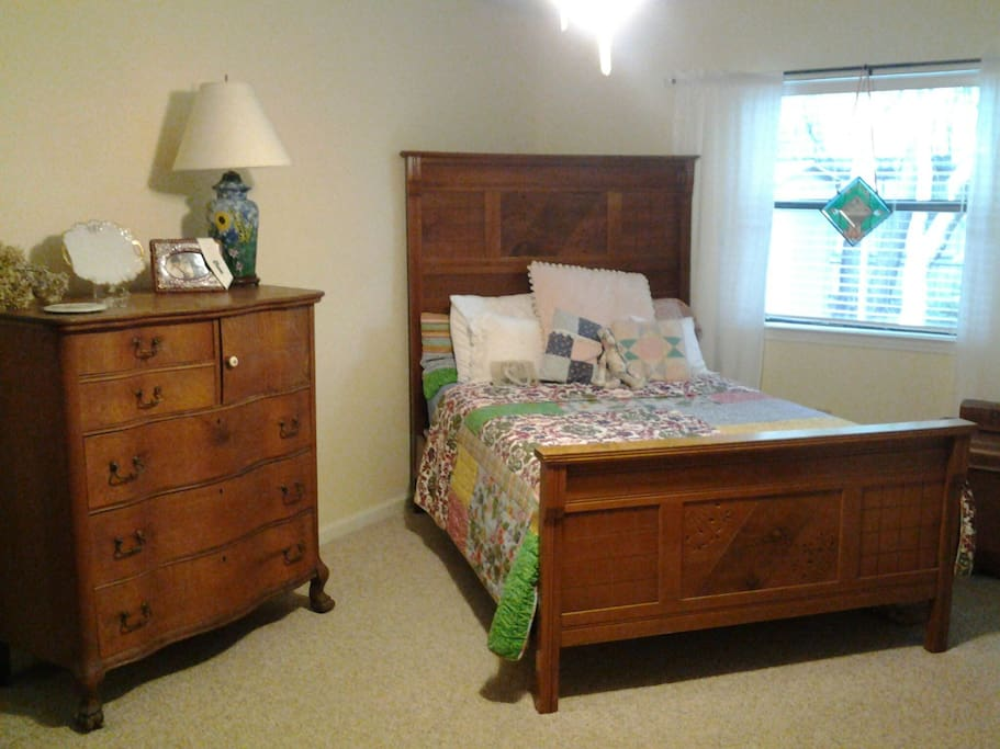 Double bed with antique headboard