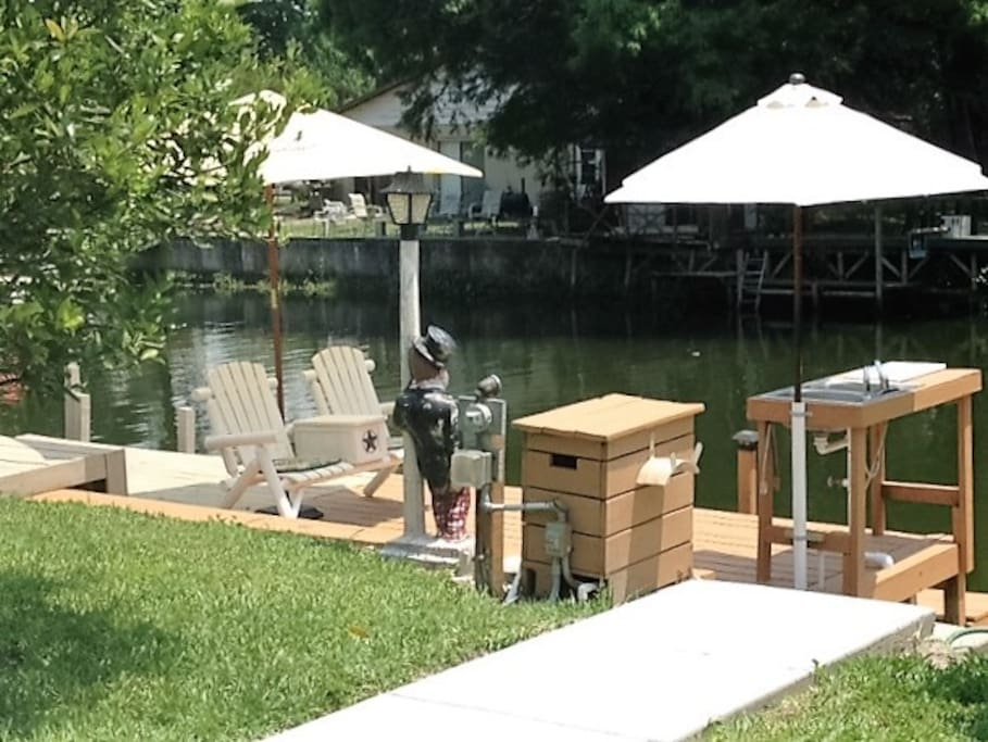 Dock includes fish cleaning sink and shaded seating.