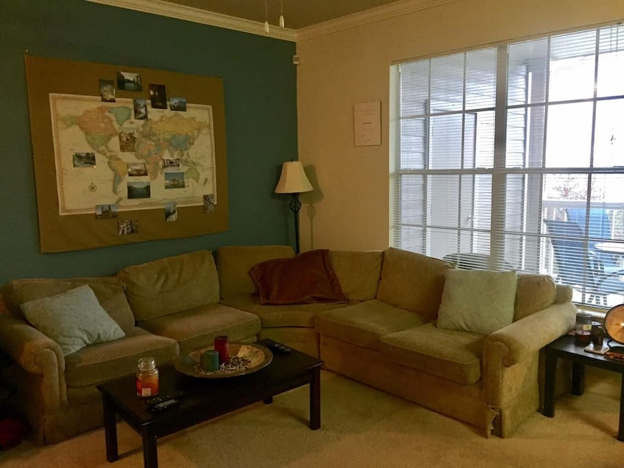 Be careful with this wrap-around couch! You might just fall asleep and miss your travel adventures. Then again, you can always travel a bit without leaving the apartment by checking out all of our travel photos and mementos we have from around the world.