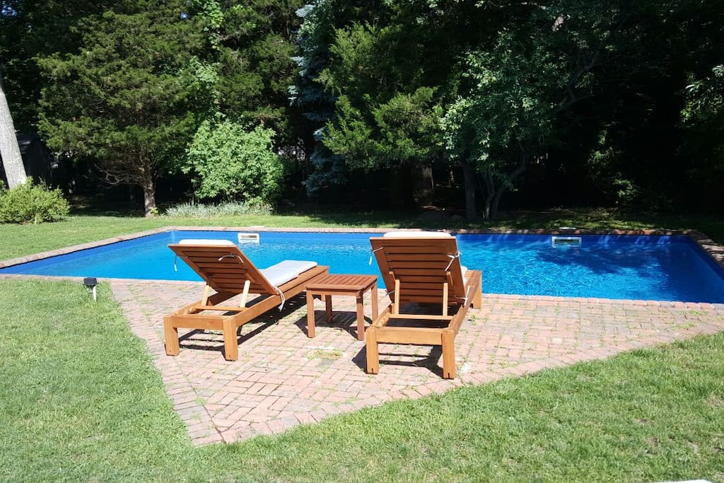 Pool patio overlooking the yard which has a nice mixture of sun and shade