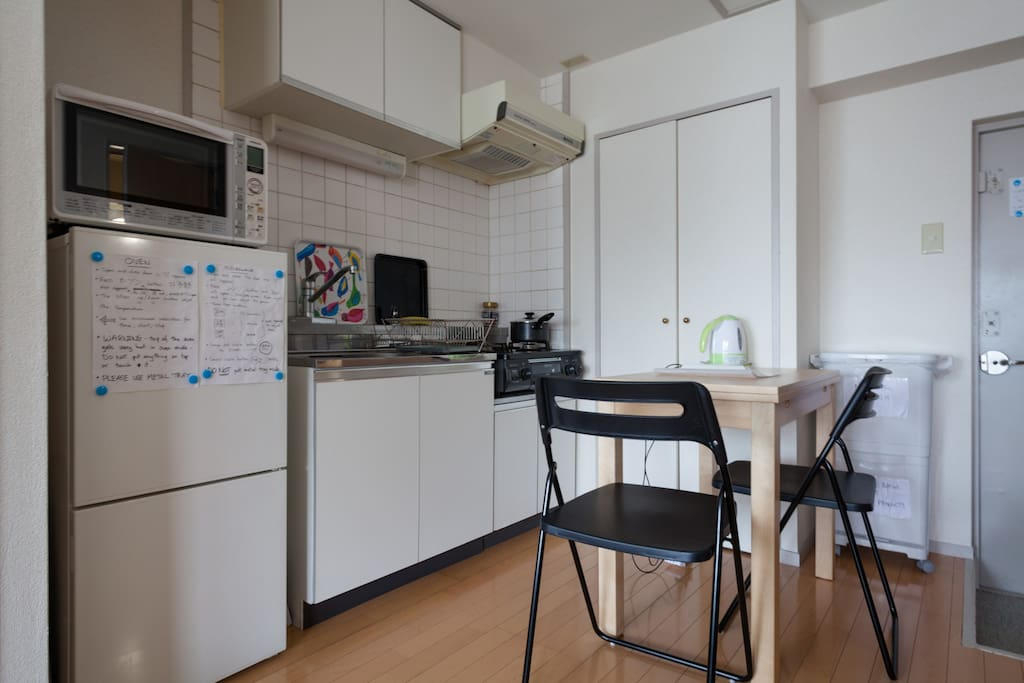 Kitchen with fridge/freezer, microwave, oven, gas rings, toaster, kettle, coffee press pot, extendable table can seat 4 and all necessary cooking utensils.