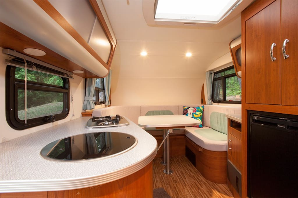 Convertible dinette sleeps 2. Kitchen with 2 burner cooktop, microwave and fridge.