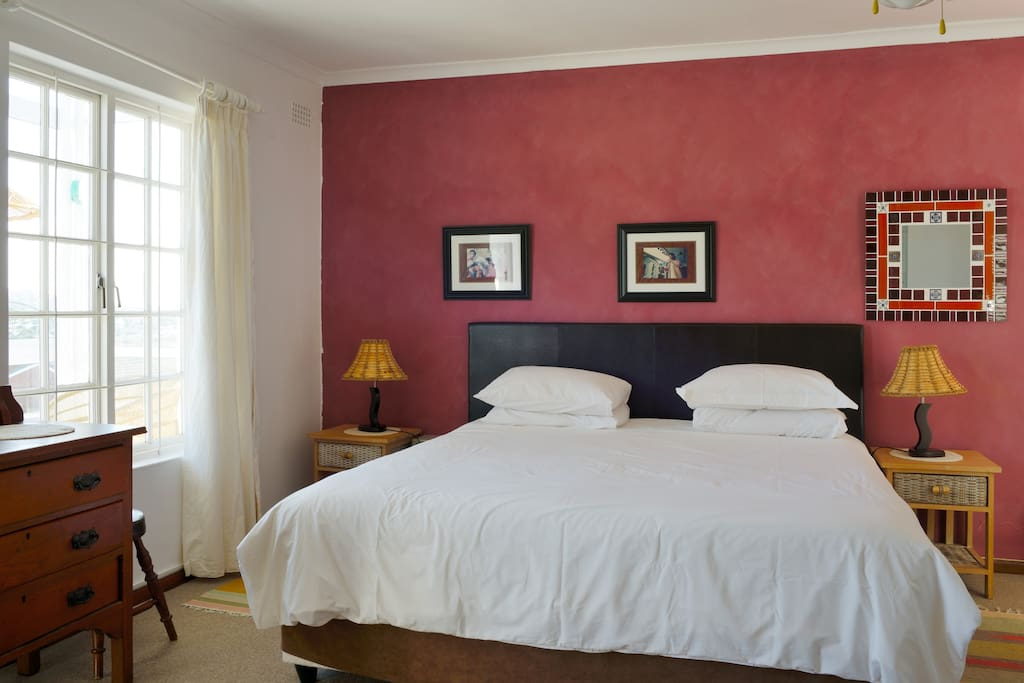 Main bedroom with king size bed and access to sun room & ensuite bathroom