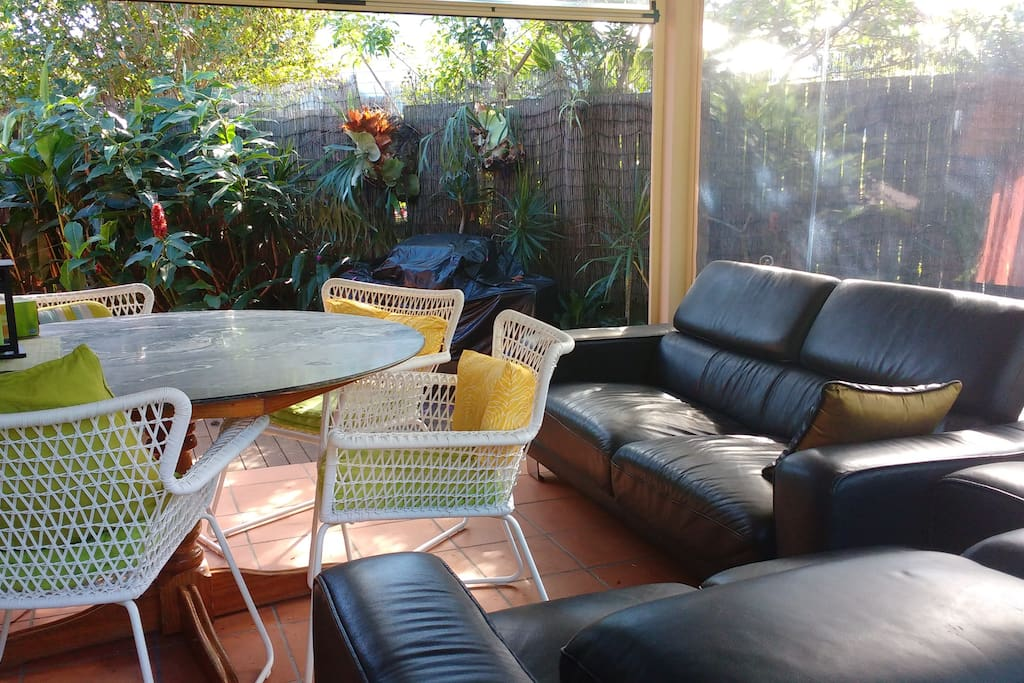 All weather conservatory for relaxing, dining, socializing, BBQ.