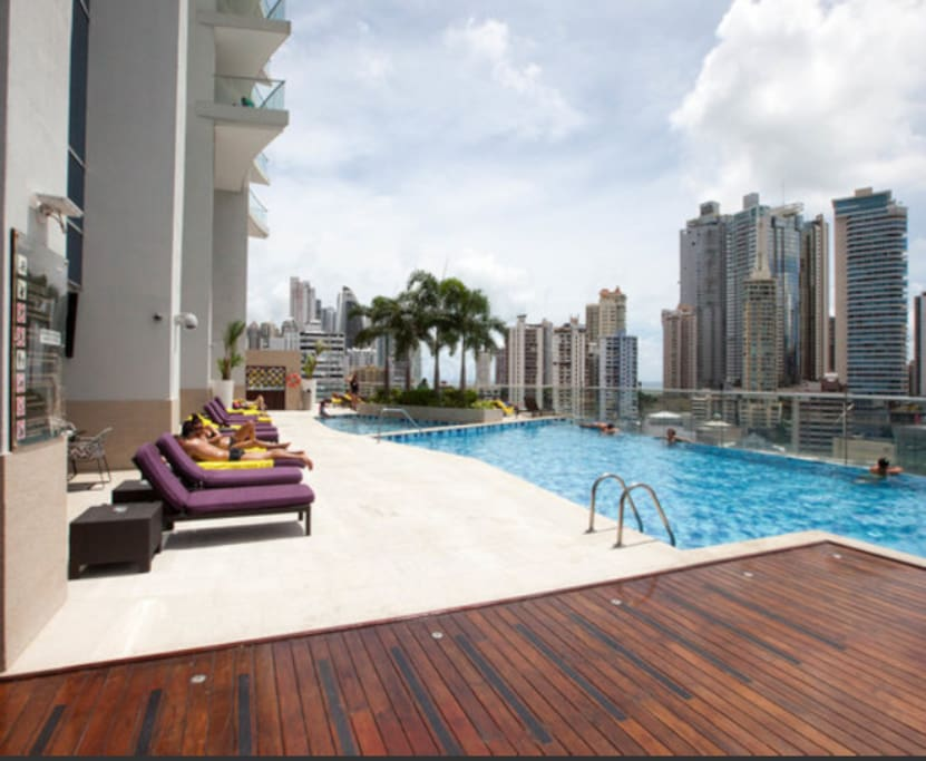 Pool area with lounge chairs and towels. Drinks served poolside