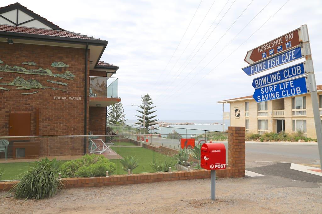 Horseshoe Bay SA with the Flying Fish Cafe Bowling Club and Surf Life Saving Club.