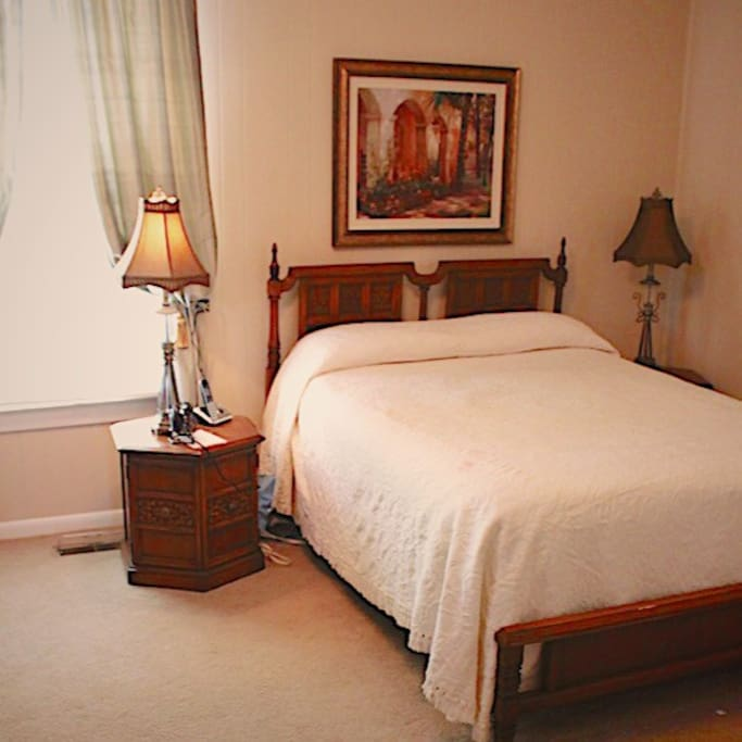 The first level master bedroom is spacious and cozy with a queen size bed.