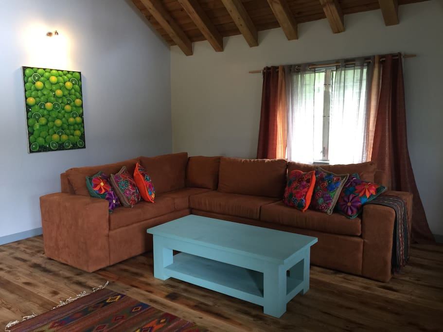 Cozy living room with comfy sofa, flat-screen TV with cable and internet.