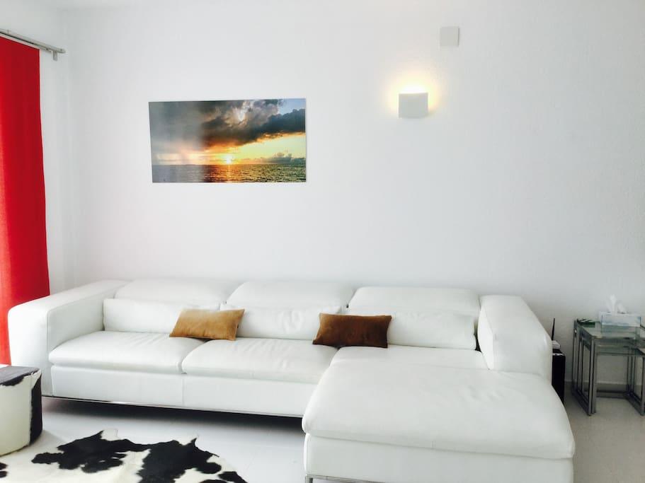 Bright, spacious lounge with stylish bespoke Italian leather sofa
