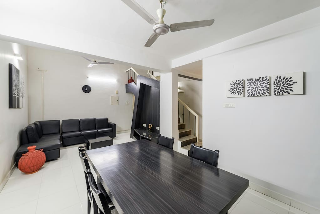 Living cum dining space with sofas and Dining table