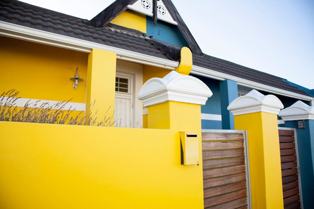 Blue House, next to yellow house.