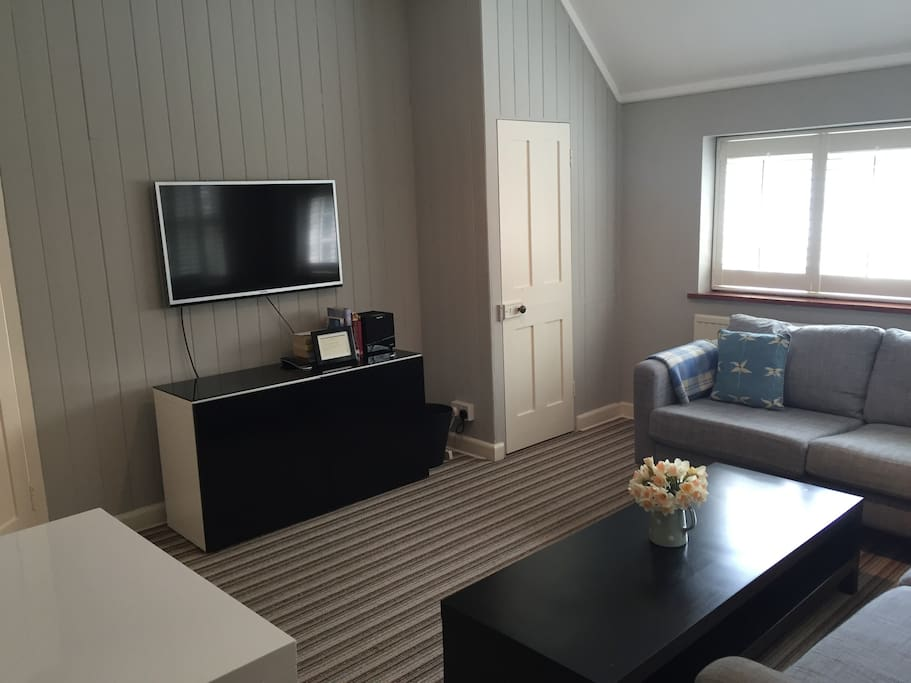 Spacious, comfortable  sitting room with Freesat TV.