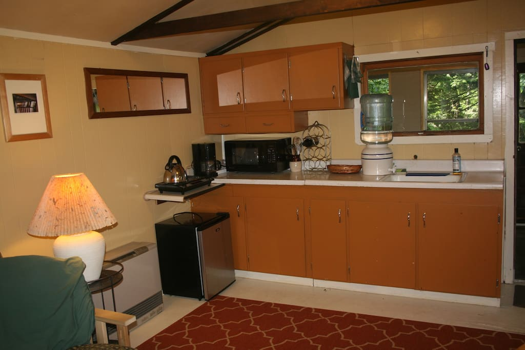 Kitchenette with two-burner stone, microwave, and mini-fridge