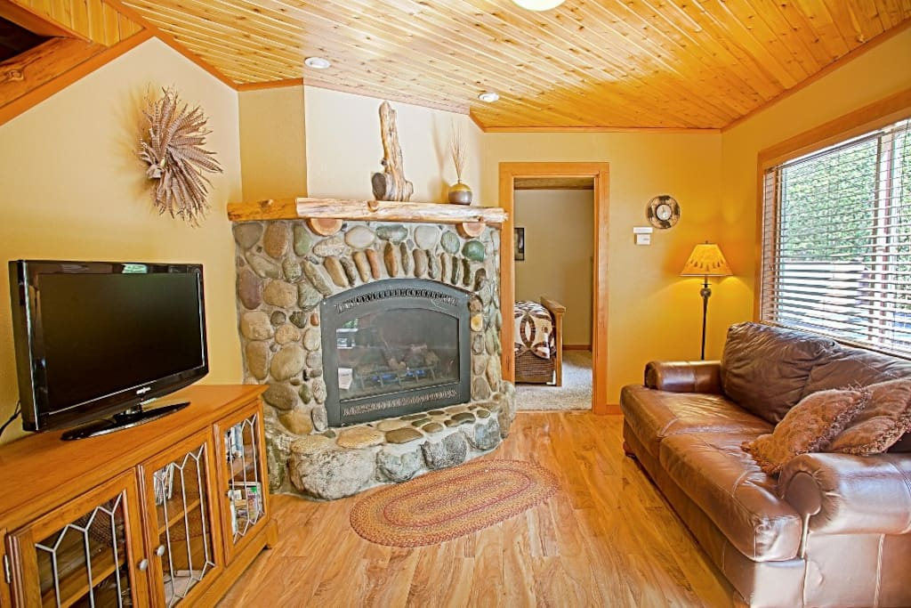 River rock fireplace and open Living Room area