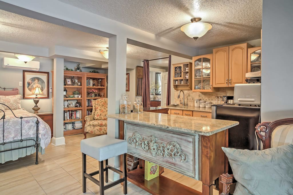 This luxurious space is perfect for a secluded getaway and features elegantly stocked cupboards, plush furniture, and a complete kitchenette.