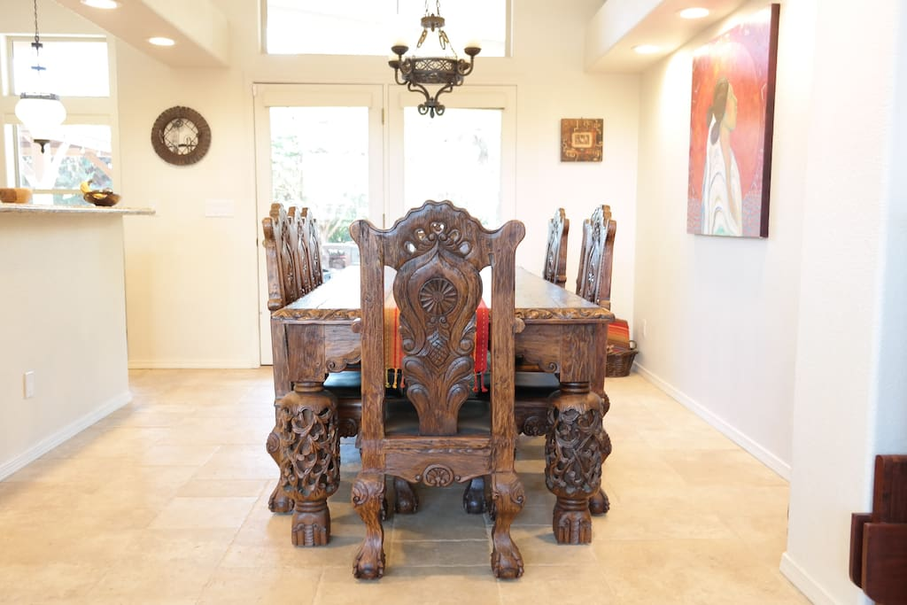 Beautiful dining room with hand carved furniture.