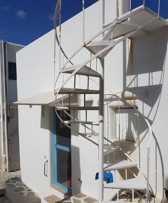 The main entrance to the house, and the  ladder leading to the rooftop.