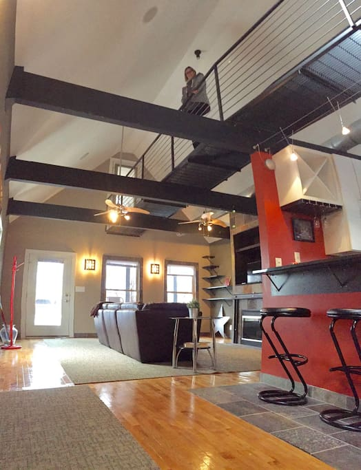 Living room/kitchen with the cat walk above