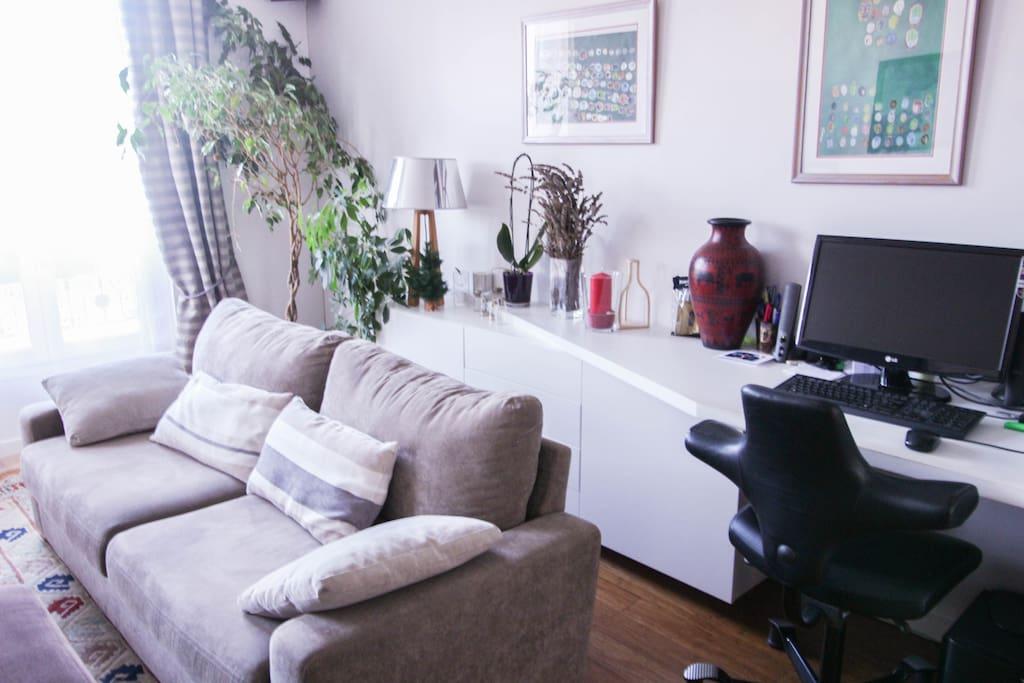 Comfortable sofa with desk