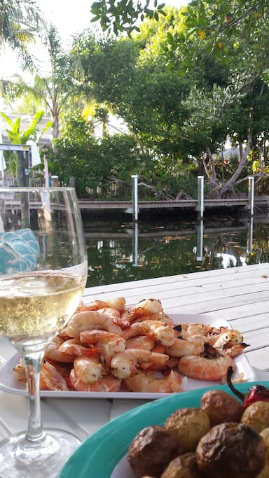Champagne & shrimp prepared by 1 Gourmet Cook guest. Served & enjoyed out on the dock.