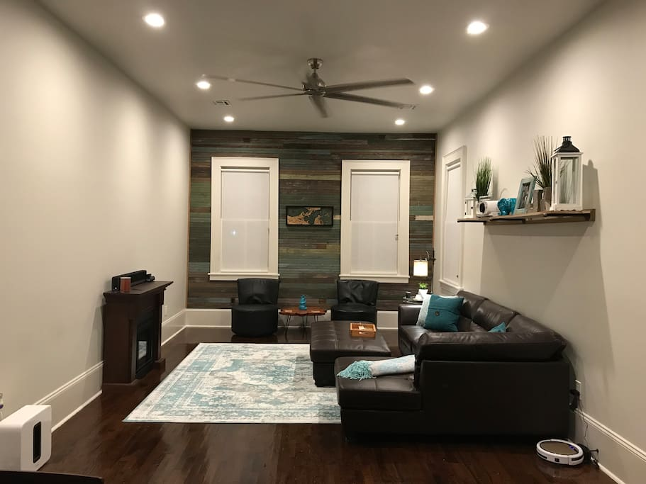 Living Room with comfy couch and projector and real flame electric fireplace