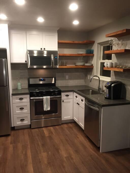 Brand new modern kitchen, fully stocked.