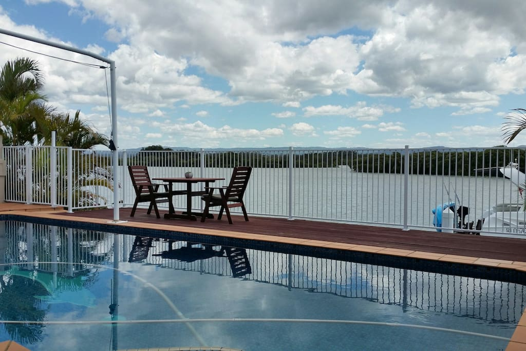 Deck and seating area for outside dining or take a dip in the pool