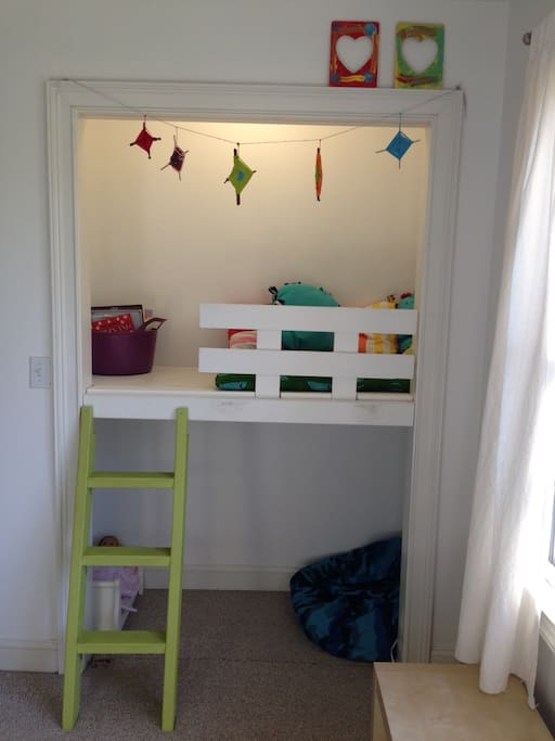 A cozy nook in the kids' bedroom is the perfect place to read or relax.