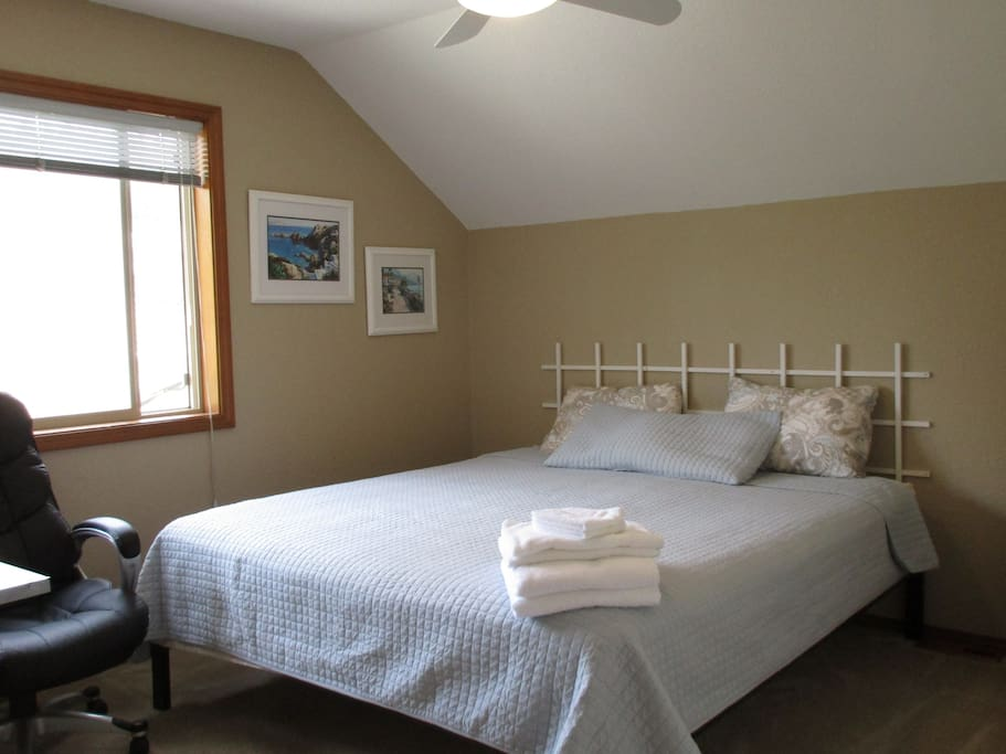 Comfortable Ca. King size bed. Extra blankets and throws in room. Ceiling fan/light w/remote.